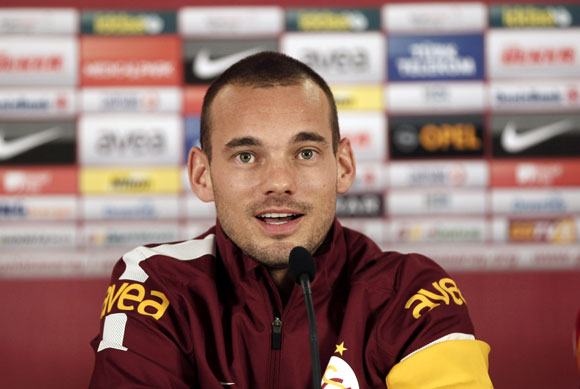 Dutch playmaker Wesley Sneijder talks to the media after signing a contract with Turkish club Galatasaray in Istanbul