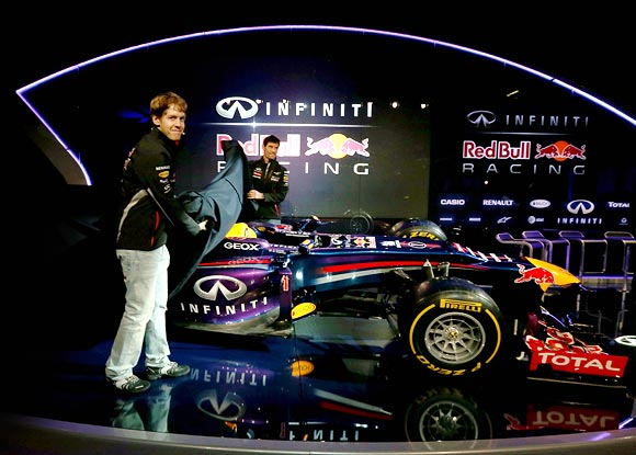 Sebastian Vettel and team mate Mark Webber reveal the Red Bull's new car RB9 for the 2013 season