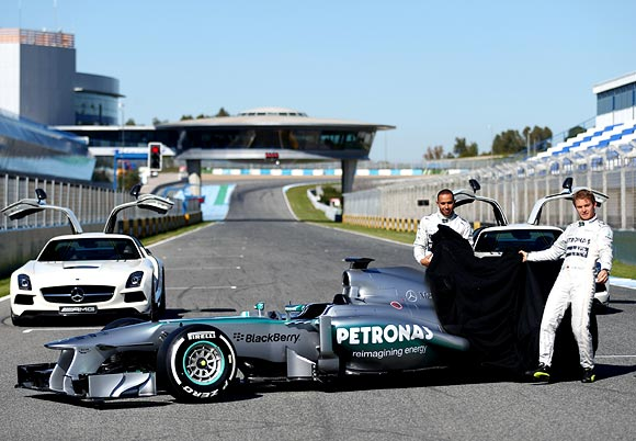 Lewis Hamilton and Nico Rosberg unveil the new Mercedes F1 car