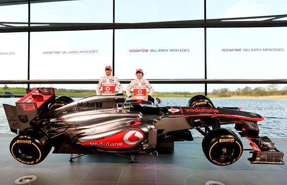 Jenson Button (left) with Sergio Perez
