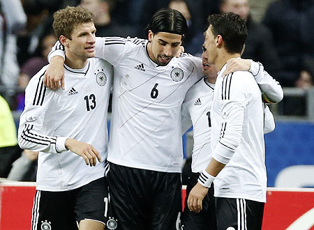 Germany's Thomas Muller (left), Sami Khedira (centre) and Mesut Oezil (right) celebrate after scoring against France during their international friendly at the Stade de France  on Wednesday