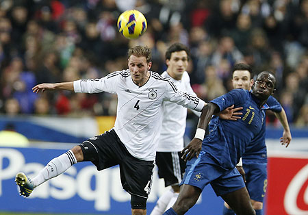 Germany's Benedikt Hoewedes (left) challenges France's Moussa Sissoko (right) during their friendly on Wednesday