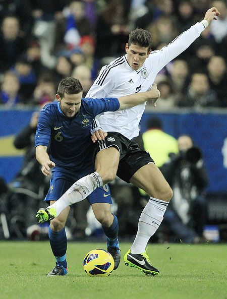 France's Yohan Cabaye (left) and Germany's Mario Gomez vie for possession during their international friendly on Wednesday