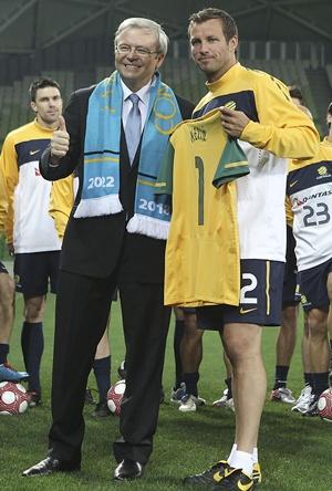 Former Australian Prime Minister Kevin Rudd with Australian captain Lucas Neill
