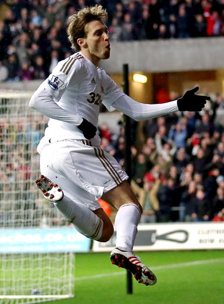 Michu celebrates scoring the opening goal for Swansea