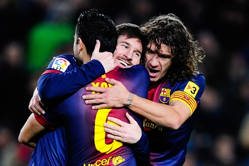Lionel Messi (centre) of FC Barcelona celebrates with his teammates