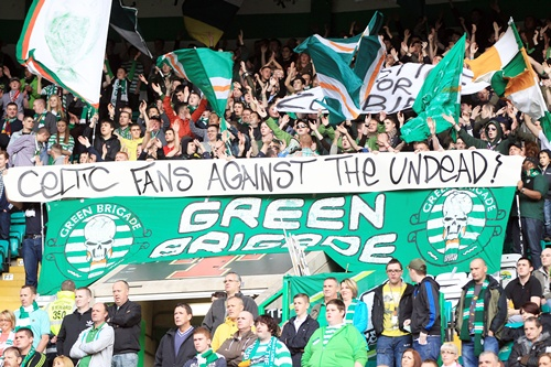 Celtic fans display a banner