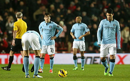 David Silva of Manchester City and Sergio Aguero of Manchester City look dejected after conceding a third goal during their EPL match against Southampton on Saturday