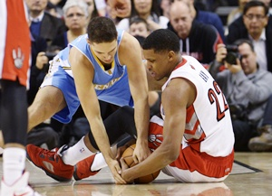 Toronto Raptors Rudy Gay fights for a loose ball against Denver Nuggets' Evan Fournier