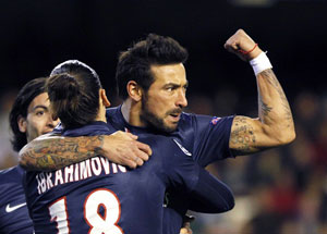 Paris Saint-Germain's Argentine player Ezequiel Lavezzi (right) gestures