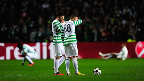 Celtic players Anthony Watt (left) and Gary Hooper look on dejectedly