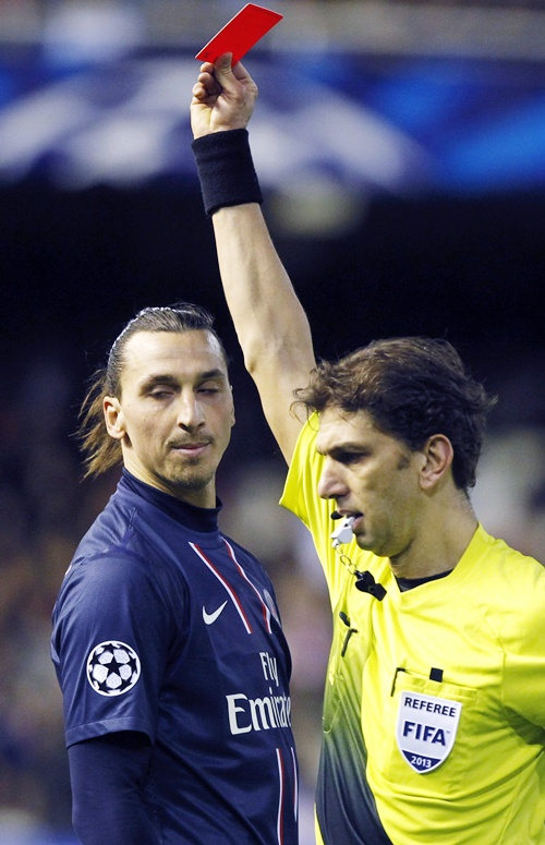 Paris Saint Germain's Zlatan Ibrahimovic (left) reacts as he is shown a red card