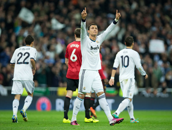 Cristiano Ronaldo of Real Madrid celebrates scoring his sides equalizing goal against Manchester United at Estadio Santiago Bernabeu