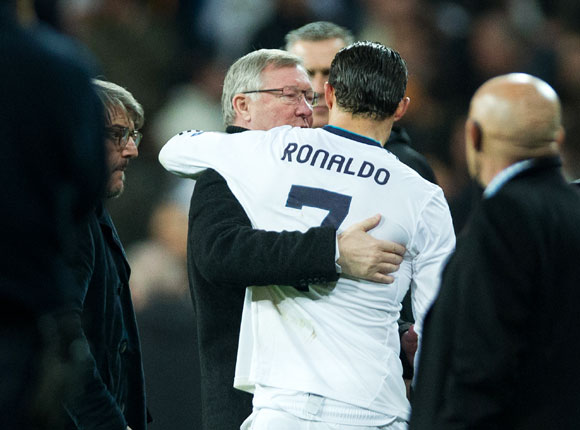 Cristiano Ronaldo (R) of Real Madrid embraces Sir Alex Ferguson, manager of Manchester United