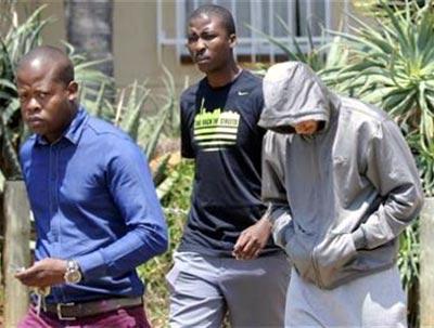 Oscar Pistorius (right) is escorted by police in Pretoria