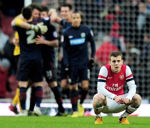 A dejected Jack Wilshere of Arsenal reacts