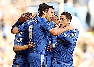Frank Lampard of Chelsea celebrates with teammates after scoring against Brentford during their FA Cup match on Sunday