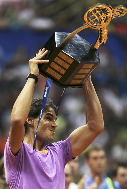 Rafael Nadal of Spain holds up his trophy