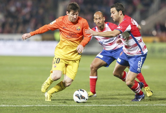 Barcelona's Lionel Messi (left) controls the ball
