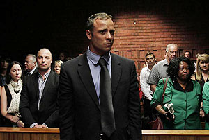 Blade Runner Oscar Pistorius awaits the start of court proceedings in the Pretoria Magistrates court on Tuesday
