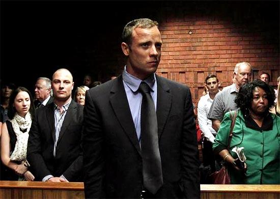 Oscar Pistorius awaits the start of court proceedings in the Pretoria Magistrates court