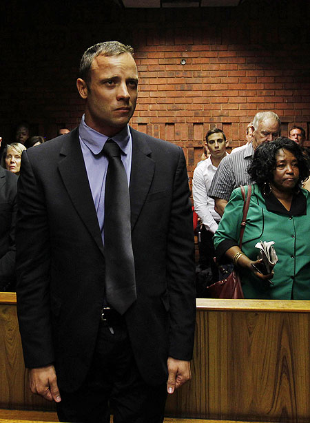 Oscar Pistorius awaits the start of court proceedings in the Pretoria Magistrates court on Tuesday