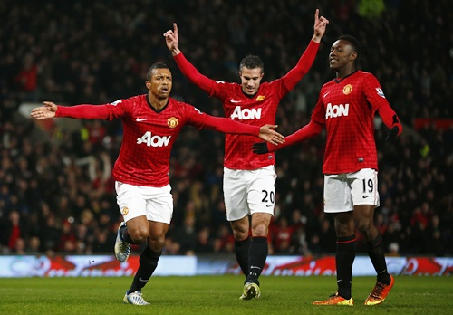 Manchester United's Nani (left) celebrates with teammates Robin van Persie (centre) and Danny Welbeck