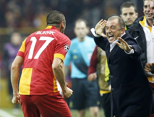 Galatasaray's Burak Yilmaz with his coach Fatih Terim
