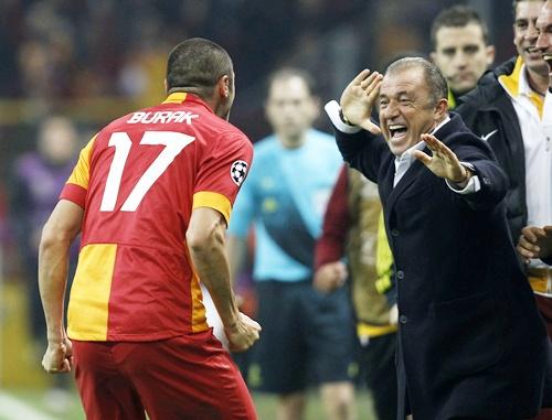 Galatasaray's Burak Yilmaz with his coach Fatih Terim