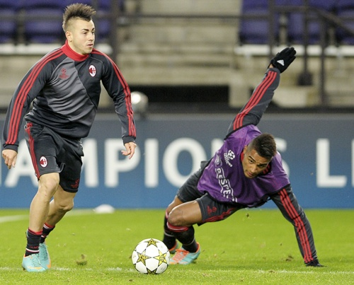 AC Milan players Stephan El Shaarawy and Kevin-Prince Boateng (right)
