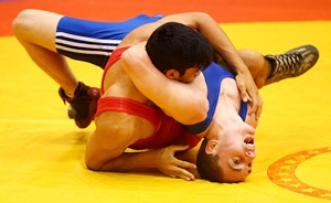 Liam Nelyland of Australia (blue) competes against Matiu Pouri-Lane