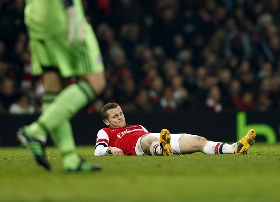 Arsenal's Jack Wilshere lies on the ground