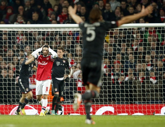 Arsenal's Mikel Arteta reacts after Bayern Munich scored