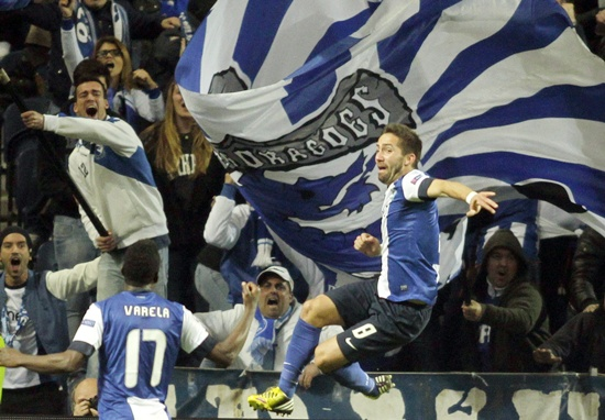 Porto's Joao Moutinho celebrates after scoring against Malaga