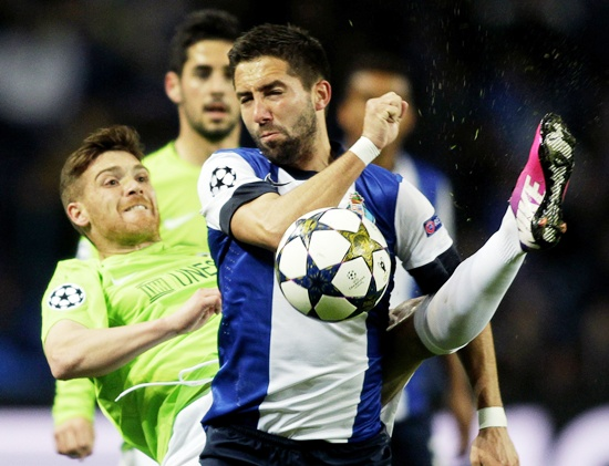 Porto's Joao Moutinho (right) is challenged by Malaga's Antunes