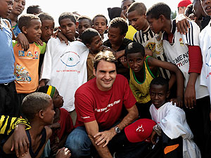 A file photo of Roger Federer with kids of a school funded by his charity