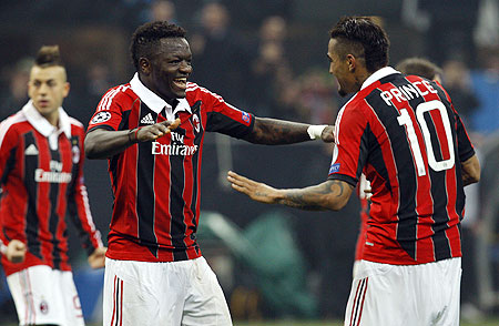 AC Milan's Sulley Muntari (left) celebrates with teammate Kevin-Prince Boateng after scoring against Barcelona on Wednesday
