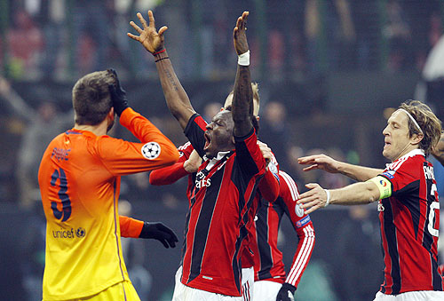 AC Milan's Sulley Muntari (centre) celebrates with teammates after scoring against Barcelona during their Champions League match on Wednesday