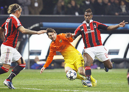AC Milan's Kevin Constant (right) challenges Barcelona's Lionel Messi (centre) during their Champions League match on Wednesday
