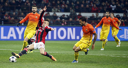 AC Milan's Stephan El Shaarawy (left) misses a scoring opportunity against Barcelona on Wednesday