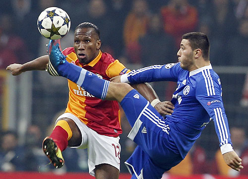 Galatasaray's Didier Drogba (left) is challenged by Schalke 04's Sead Kolasinac (right) during their Champions League match on Wednesday