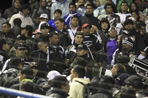 Members of Bolivia's police are seen amid Brazil's Corinthians fans