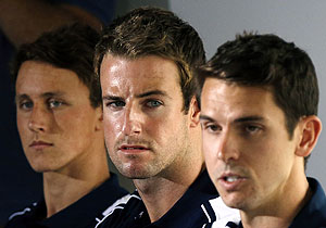 James Magnussen (centre) sits with teammates Cameron McEvoy (left) and Eamon Sullivan from Australia's 4x100m freestyle relay team at the London Olympic Games during a media conference at a hotel in Sydney on Friday