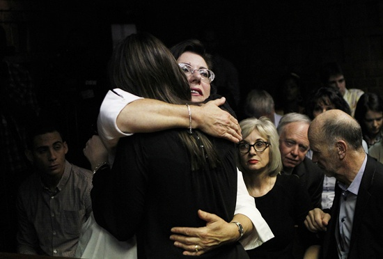 Relatives of Oscar Pistorius hug each other