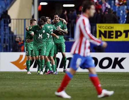 Rubin Kazan's players celebrate a goal against Atletico Madrid