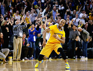 Jarrett Jack of the Golden State Warriors celebrates after making a three-point basket in the fourth period of their game against the San Antonio Spurs on Friday