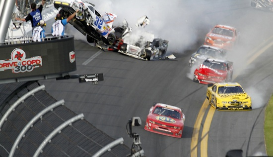 NASCAR driver Tony Stewart (bottom right) avoids a crash on the last lap