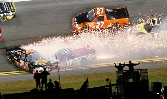 Sparks fly from Ryan Truex in his number 30 Chevrolet (left)
