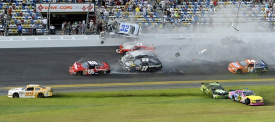 NASCAR driver Kyle Larson (32) and his Chevrolet end up in the fence during the final lap crash during the NASCAR Nationwide Series