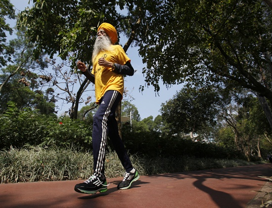 Fauja Singh jogs during a practise at a park in Hong Kong